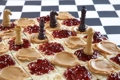 PB vs. Jelly  Chess game between peanut butter and jelly on a cracker checkerboard with alternating colors made fromSmooth Operatorpeanut butter and raspberry jelly.   Conceived By Lee ZalbenPhotography By Theresa Raffetto Food Styling By Matt Vohr