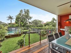 My ideal backyard! Three tiers, from a back porch/patio/deck, to a little manageable green space to a beautiful pool. Love it, doesn't hurt that it's in Australia too.