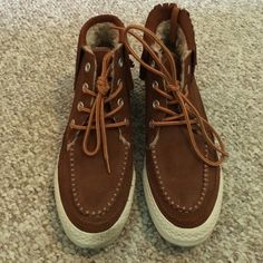WORN ONCE Chuck Taylor moccasin style Converse Size 6, but they fit big. I am an 8 and they fit me. Been worn outside once. Perfect condition. They have a whole lining around the top of the inside, you can see it in the last picture Converse Shoes