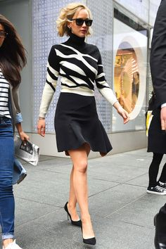 Who: Jennifer Lawrence What: The Skirt   Knit Why: The actress is embracing manic weather in a fitted high contrast knit and mini skirt, both by Dior. The trick is to skip the tights and maintain the elegance. Get the look now: DKNY sweater, $255, net-a-porter.com.   - HarpersBAZAAR.com
