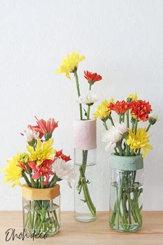 diy flower vase with glass bottle and jar Bottles And Jars, Glass Bottles, Diy Flowers, Flower Vases, Concrete Candle Holders, Hanging Vases, Concrete Texture, Paint Brands, Paint Drying