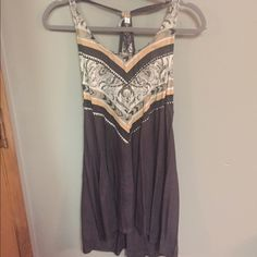 Ripcurl asymmetrical coverup with side detail Ripcurl swimsuit coverup with cute knot detailing on sides and asymmetrical bottom. This has been worn through one short vacation- bought in Maui, fabric seems faded, but that's the style/design of it. Ripcurl Swim Coverups