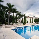 The palatial Villa Vecchia mansion in Miami was built in 1928. The gated estate features 18,000 square feet of living space and includes custom crown moldings, terazzo and hardwood floors, and a lovely outdoor pool. See more of the home at HGTV FrontDoor.com.   HGTV FrontDoor