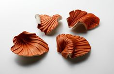 Catherine Truman Brooch: Ra Shells, 2011 Carved English Lime wood, Shu Niku ink, sterling silver, steel 10 x 10 x 3 cm each Photo by: Grant Hancock © By the author. Read Klimt02.net Copyright.
