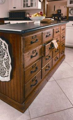 Vintage wooden filing cabinets turned kitchen island - Love the idea of additional drawer space in kitchen.