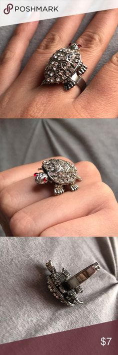 Turtle ring (adjustable) This is a super cute turtle ring. The legs, head and tail move. In great condition, except the ring part is a little scratched. Otherwise the turtle looks new. Jewelry Rings