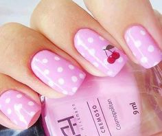 Baby pink with white polka dots and red cherries accent nail art. #nails #nailart #manicure