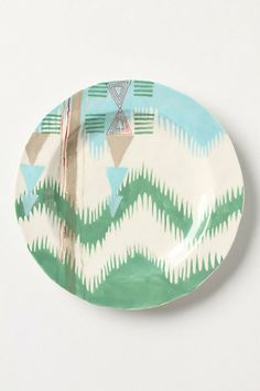 Sacaton Dinner Plate - Anthropologie.com. i love the idea of using pretty plates as wall decorations
