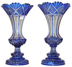 Pair of Blue Cut-To-Clear Glass Vases - $1400. - don't understand quite how its done, but love the look of it.
