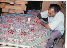 Artist painting Moroccan table. Fantastic handcraft. www.asilahventure...