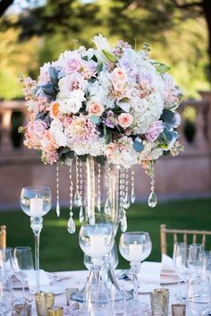 Photographer: Paul Barnett Photography; Stunning outdoor blush, purple and white floral wedding reception centerpiece with glass vase;