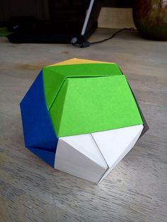 Module origami. Dodecahedron. Designed by Tomoko Fuse. Folded from 12 sheets of 11.7cm kami.