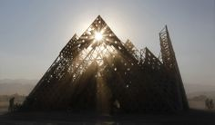 """The sun sets over the """"Cradle of Mir"""" art installation during Burning Man 2013, on August 30, 2013."""