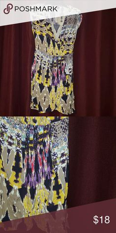 Mossimo abstract print colorful dress Faux wrap dress. Flowy and colorful! Purple, black, tan, red, light blue, yellow. 100% rayon stretchy material. Mossimo Supply Co Dresses Mini