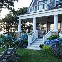 Beachfront Cape Cod house with a porch - and puffy hydrangeas.  This whole house is incredible - just wait until you see the rest!