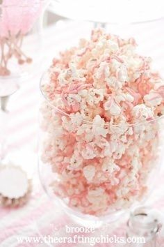 white chocolate popcorn drizzled with pink candy melts
