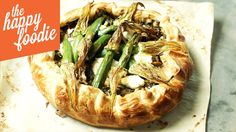 Corsican Pie With Zucchini Flowers by Yotam Ottolenghi. The tart used herbs, greens , cheese and zucchini flowers.