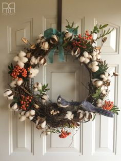 Cotton buds, berries and bluejays make for a perfect fall wreath!