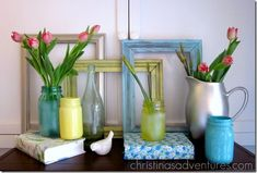 Cheery spring mantle - stacked frames, mason jars, fabric covered books, tulips & daffodil buds