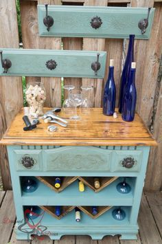 See how to turn an old dresser into a classy wine bar with background hooks (pull out draws).