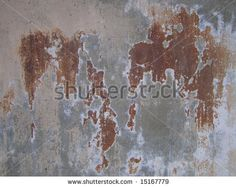 Abstract background of concrete wall with rust color stain showing by Neil Lang, via ShutterStock