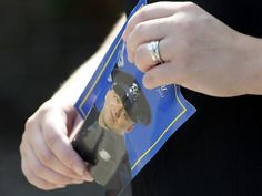 A woman carries the memorial service program with fallen