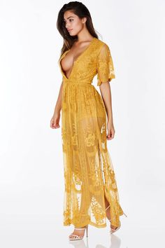 08a2d52ca17 A magnificent mesh maxi dress with intricate crochet detailing throughout.  Flowy short sleeves with an elegant wide V-neckline. Hidden zip back  closure with ...