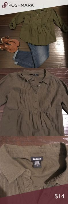 Torrid Army green top Cute army green top with lots of wear left. It has a stretchy backing and is super comfortable. (smoke free/pet free home. Accessories not included) torrid Tops Blouses