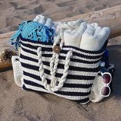 Its an adorable beach bag i would love to own or make.