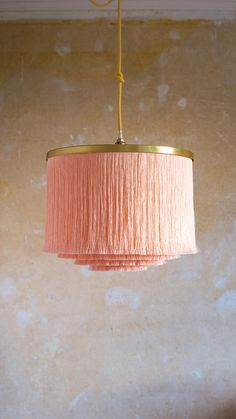 *P I L L O W T A L K* Softest shell pink silky fringe in four tiers drips from a brass trim. This lampshade is ready to make a statement wherever it's hung. We've created a range of fringe pendant light shades in three sizes and a variety of colours and fabrics from poppy brights