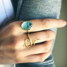 A perfect pair: Gabriella Kiss' 18k large snake ring with diamond eyes & her 18k scalloped bezel set aquamarine ring. #gabriellakiss #18k #snakering #aquamarine @lovegoldlive #lovegold #futureheirlooms #finejewelry #showmeyourrings #augustla