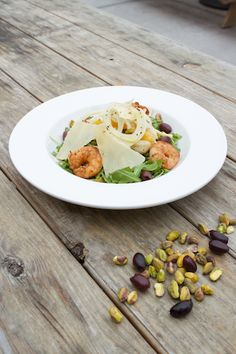 Prawn and citrus salad with seared prawns, market citrus, pistachio, kalamata olives, shaved fennel, parmigiano, arugula, and lemon vinaigrette