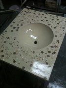 Custom concrete sink with glass tile and mirror