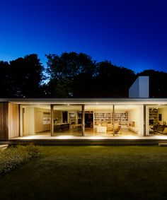 ström architects cantilevers modern-day bungalow in england from a stone wall