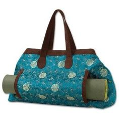 The Tadasana Tote by Athleta has a side pocket for easy yoga mat storage.