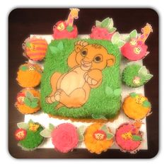 My favorite cake inspiration yet!  I totally want a Lion King baby shower.  So nostalgic of my own childhood...  ;)