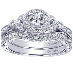 14K white gold .42cttw vintage halo diamond engagement ring with .15ct H/SI1 center diamond. This vintage inspired engagement ring has bead set side diamonds and an engraved shank. Price is for comple