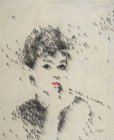 By Craig Allen, an aerial shot of people arranged to form a portrait of a woman.