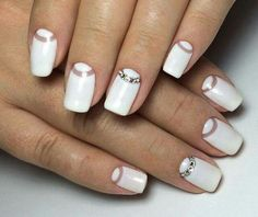 White nails with rhinestones. Something different.