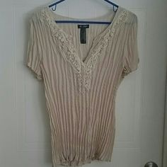 Beige sheet short sleeve blouse Pretty big age or tan short sleeve wrinkle cloth blouse. Has embroidery around good. Kind of sheer so it probably would need a camisole under it. Axcess Tops Blouses