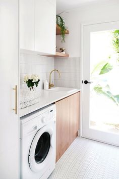 MY LAUNDRY RENOVATION REVEALED — Adore Home Magazine Love the white and wood combo, just white cabinets would be too white. The full light door makes the room sunny and cheerful. Laundry Decor, Laundry Room Remodel, Laundry Room Organization, Laundry Room Design, Laundry In Bathroom, Kitchen Remodel, Laundry Closet, Organization Ideas, Laundry Storage