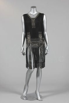 A beaded black crepe de chine flapper dress, circa 1926, beaded with silver bugle and oval beads, larger pearlised discs, with elaborate fringed skirt