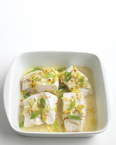 Steamed Cod With Ginger Martha Stewart - Fish Is A Great Source Of Lean Protein Try This Super Easy Cod Dish That Gets Its Flavor From A Tasty Asian Marinade In A Shallow Quart Microwave Safe Dish With A Lid Stir Together Scallion Wh Cod Dishes, Fish Dishes, Seafood Dishes, Fish And Seafood, Main Dishes, Tasty Dishes, Shellfish Recipes, Seafood Recipes, Cooking Recipes