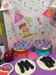 Shopkins themed birthday party. Backdrops made from display boards, scrapbook papers and Shopkins posters