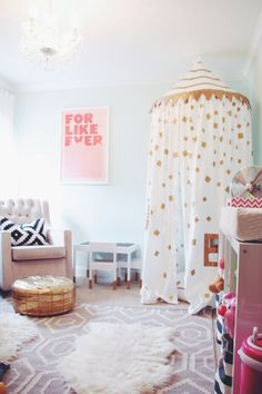 For Like Ever print, Land of Nod playhouse canopy, sheepskin rug, gold pouf, mint walls, gray moroccan dhurrie rug