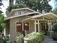 airplane bungalow with eye-catching pillars by FL Architect Fan, via Flickr