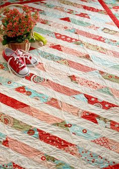 Red and Aqua quilt (Bliss, of course!) using the Strip-Smart Ruler by Kathy Brown, click on pic and see a mini tut (really, all you need because this ruler makes it THAT easy!)