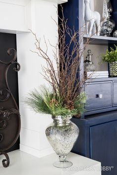 Branches and greens make an elegant floral display.