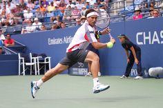 David Ferrer (ESP)[4] in action against Lleyton Hewitt (AUS) in the third round. - Billie Weiss/USTA