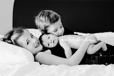 Tips for photographing a newborn with siblings